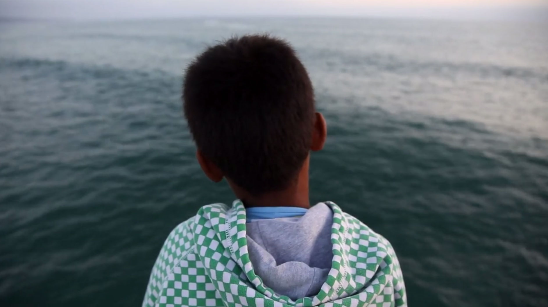 boy looking at water